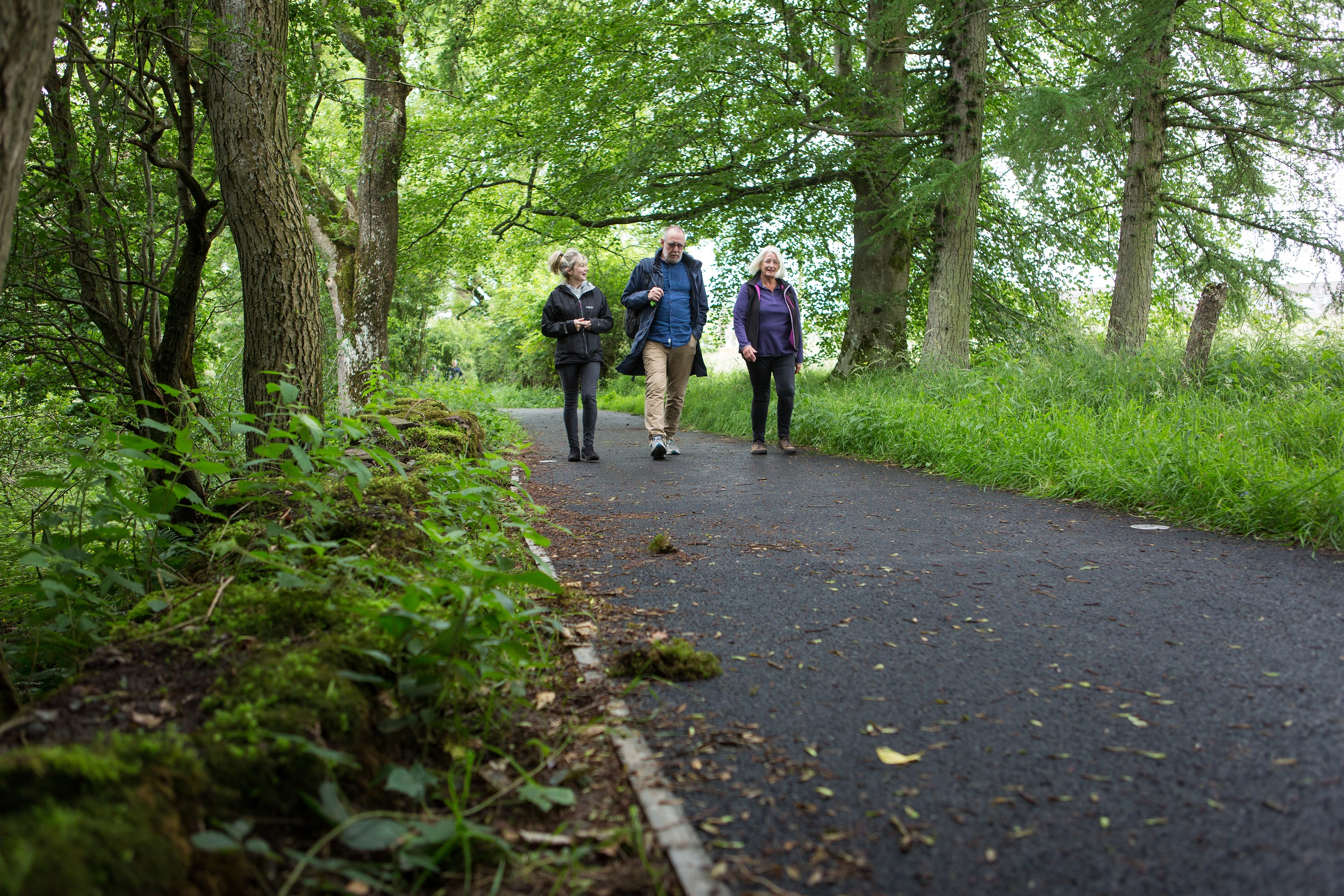 Jane Courtney, Auchterarder Core Paths Working Group, along with Stuart, former Chair of Auchterarder Community Sports Association) and Alison Bonney walk along the upgraded Provost Walk ©PKCT