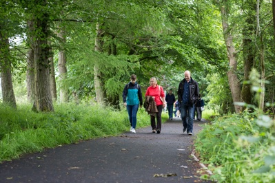 Nina Gillespie of Tactran, Julia Howe of the Auchterarder Core Paths Working Group, and Daryl McKeown of PKC Traffic Services walk the opened path ©PKCT