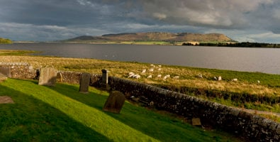 View from across Loch Leven from Kirkgate graveyard to towards Benarty Hill, Kinross, Perthshire © VisitScotland / Paul Tomkins, all rights reserved.