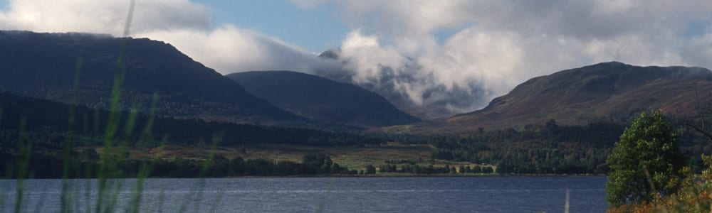 LOOKING OVER LOCH RANNOCH- A LOCH AND RESERVOIR 10 MILES LONG, TO CLOUD SHROUDED MOUNTAINS BEYOND, PERTH & KINROSS © VisitScotland / Paul Tomkins, all rights reserved.