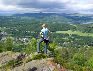 Person looking across the five lochs from Birnam Hill